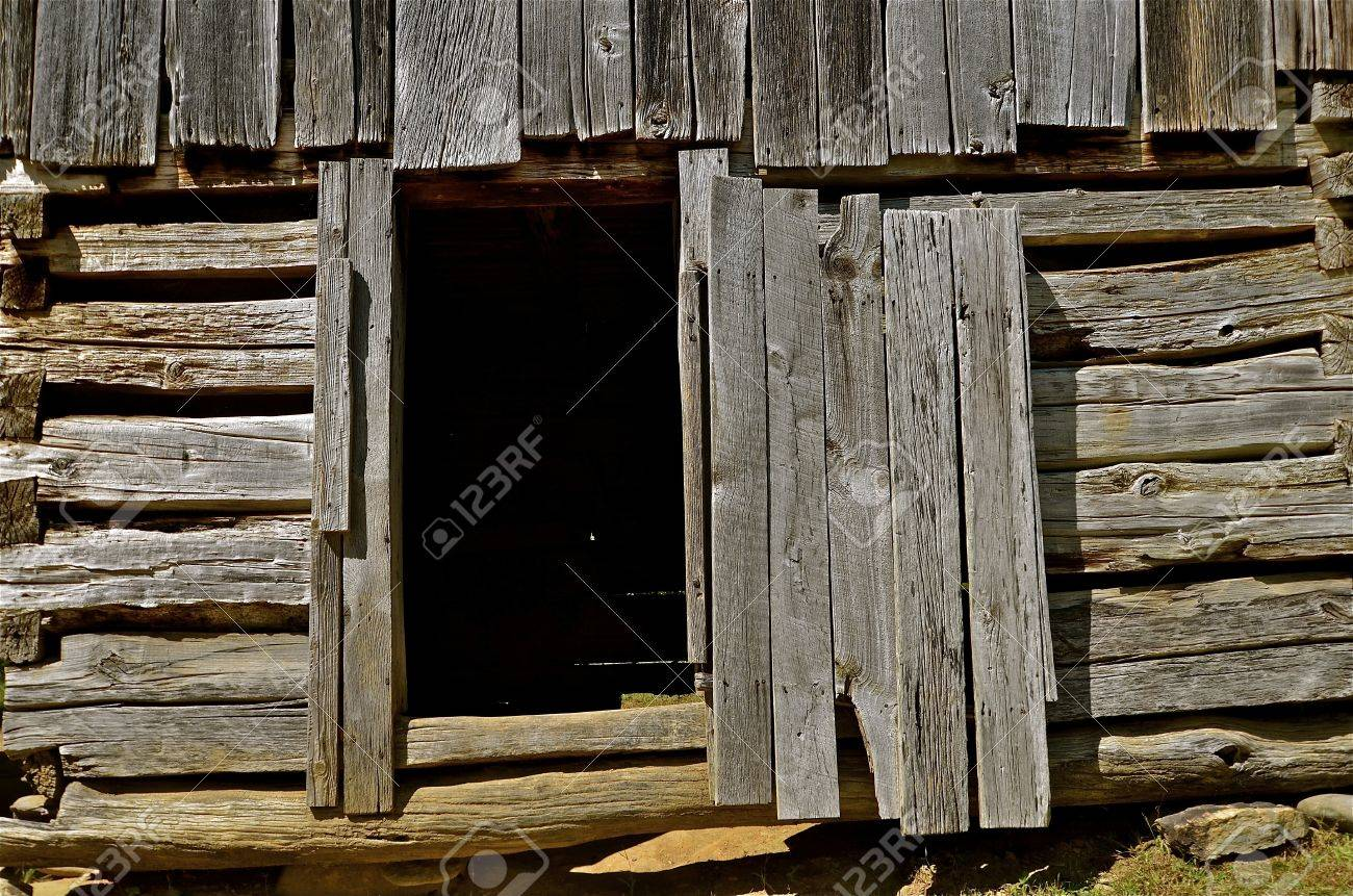 Open Shed Or Barn Door Of Old Weathered Graying Wood Stock Photo