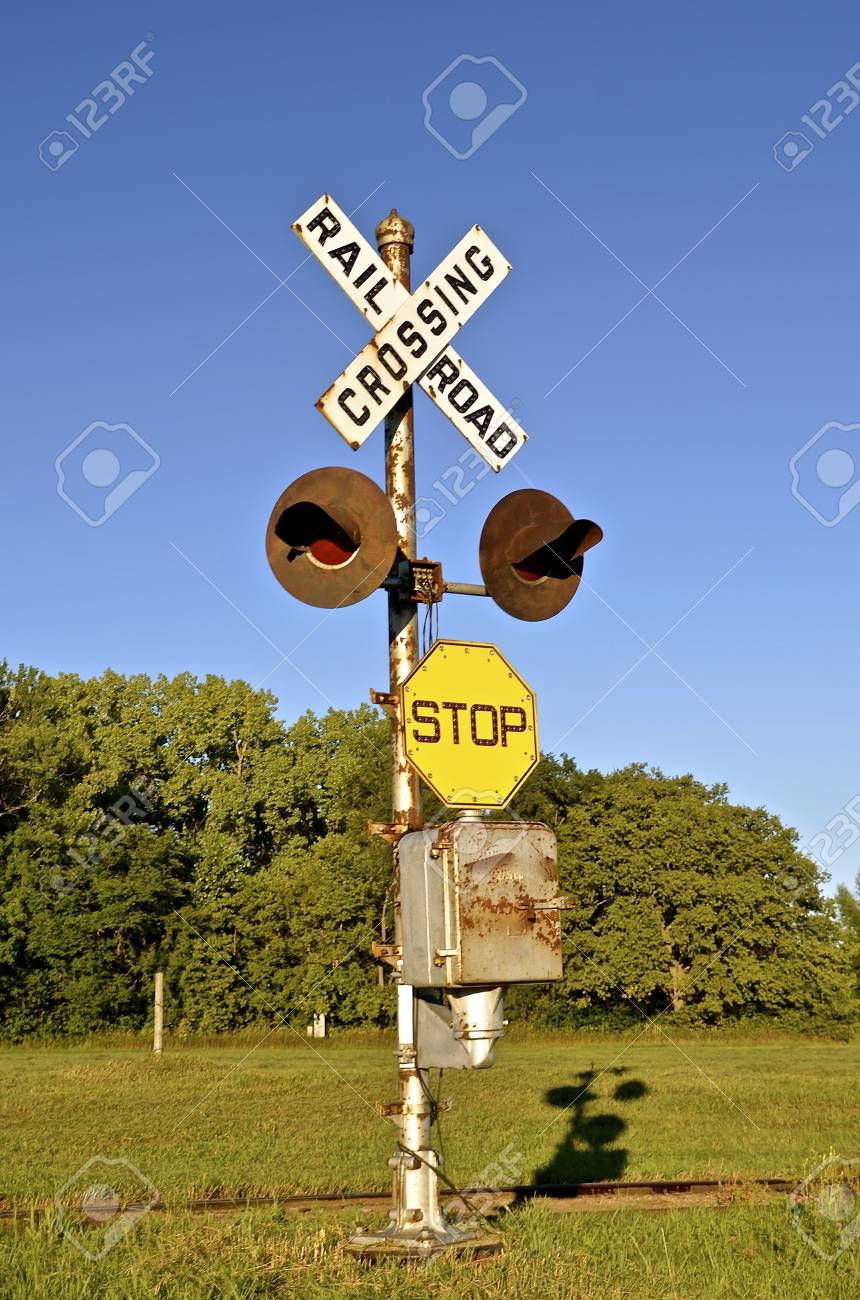 An old vintage railroad crossing sign with no crossbars
