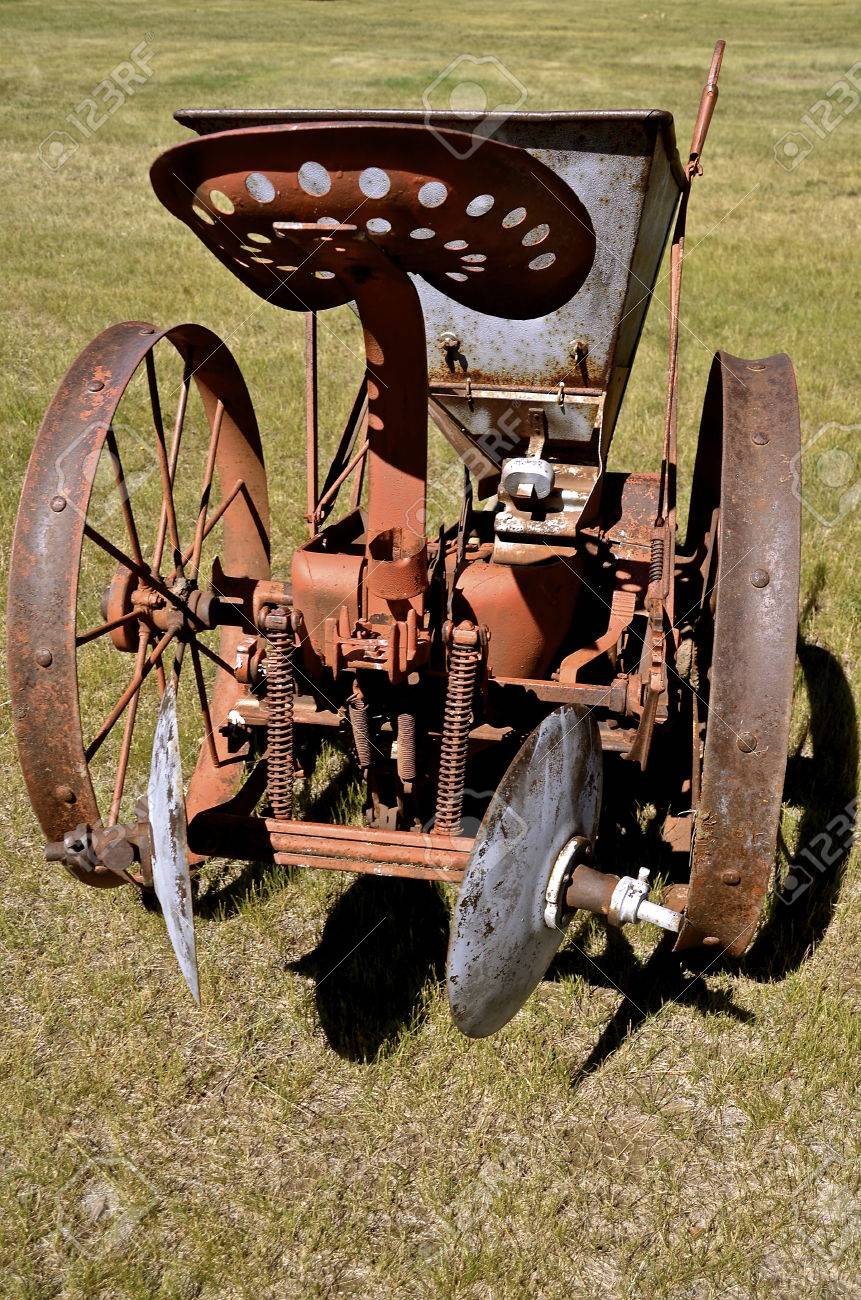 An Old Horse Drawn One Row Potato Planter With A Seat For The