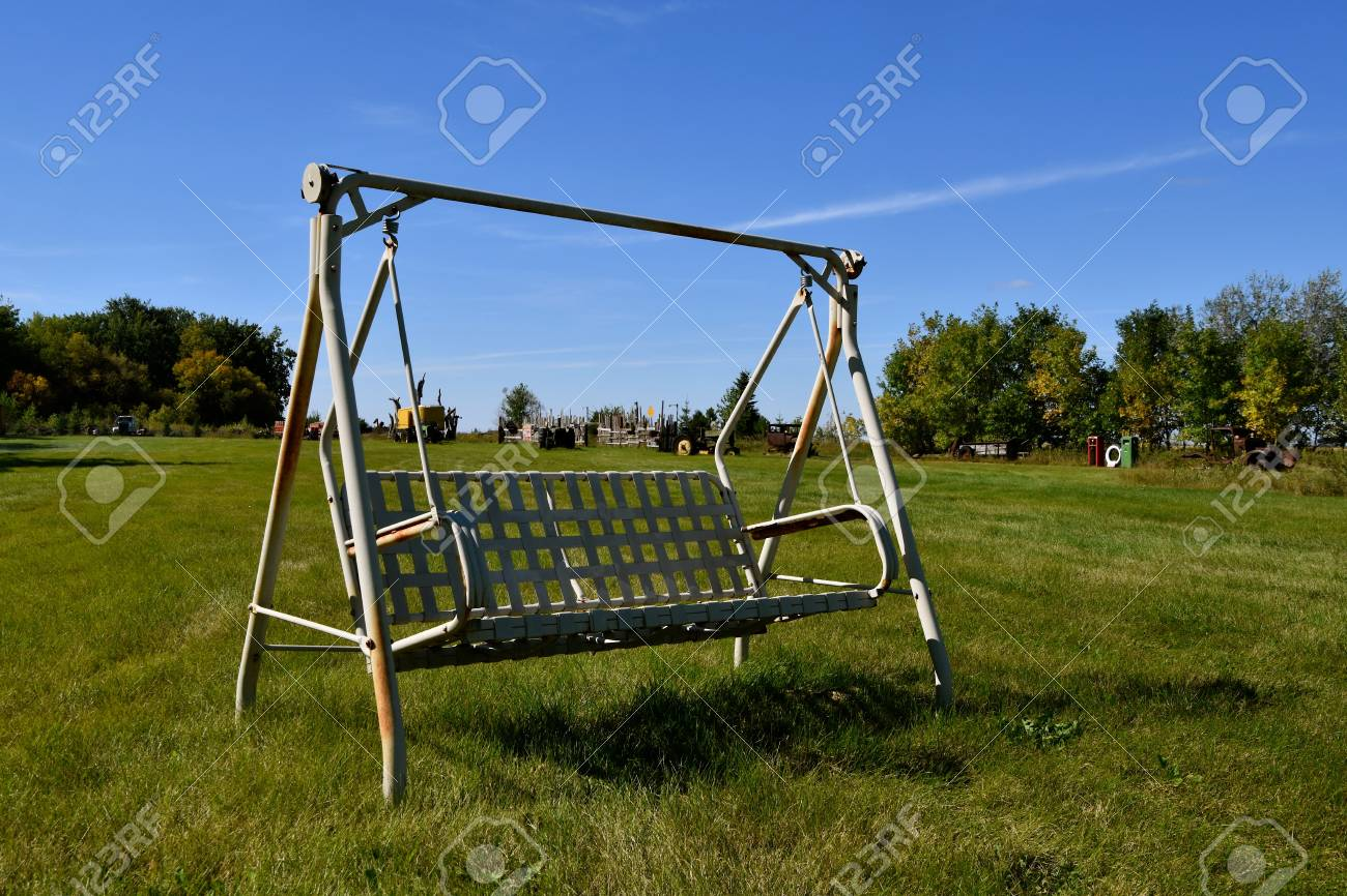 Comfortable Outdoor Swinging Chair For Two In A Pasture With Stock