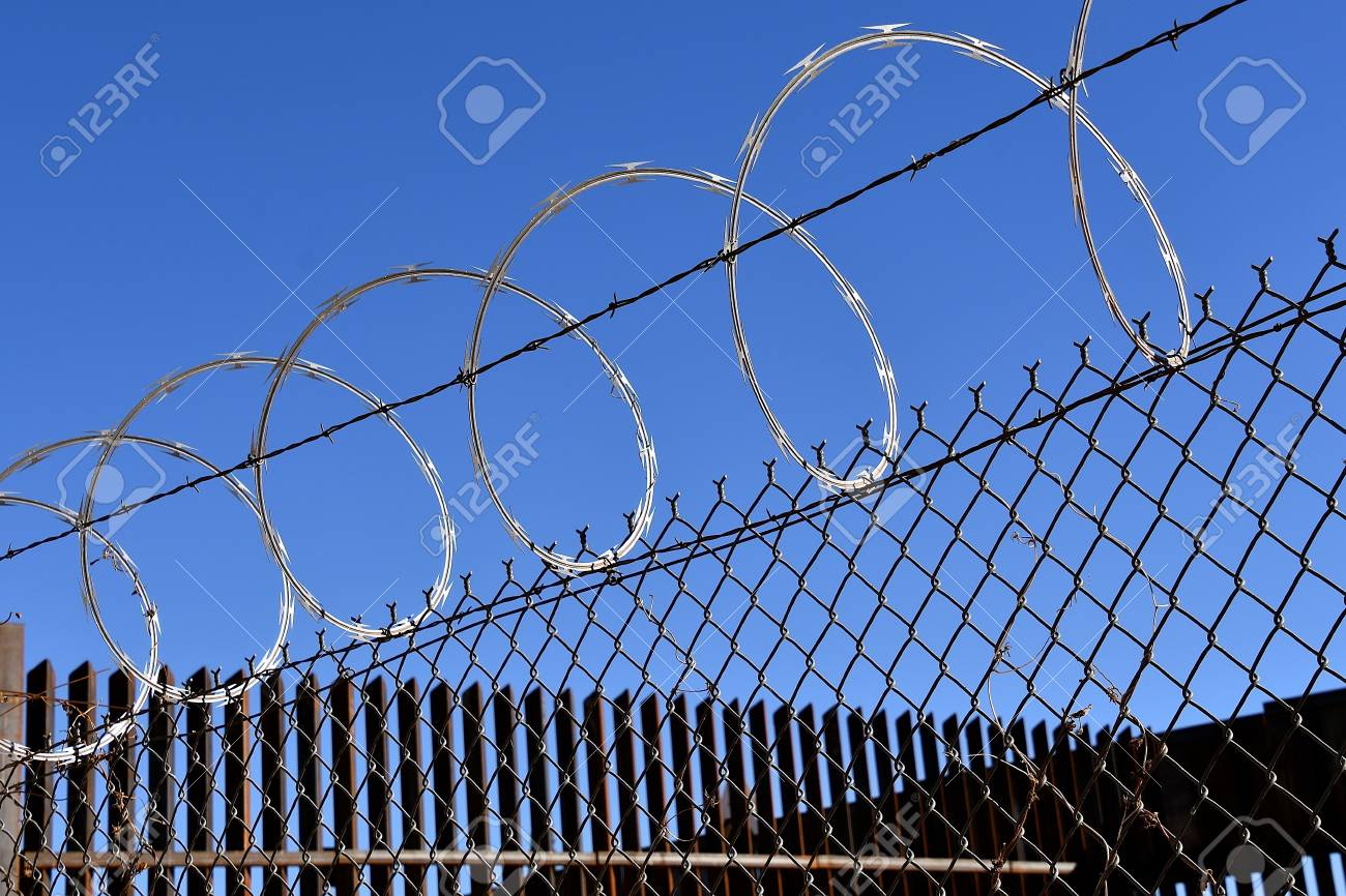 Razor Sharp Concertina Wire On Top Of Fences Which Provide A.. Stock ...