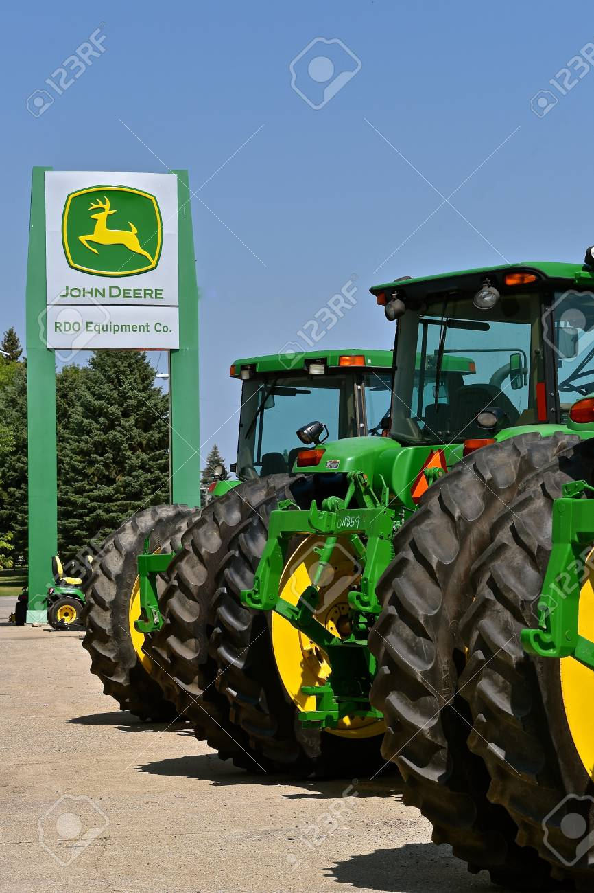 KINDRED, NORTH DAKOTA, August 21, 2018; The tractors and John Deere signs are products of John Deere Co, an American corporation that manufactures agricultural, construction, forestry machinery, diesel engines, and drivetrains - 110805774