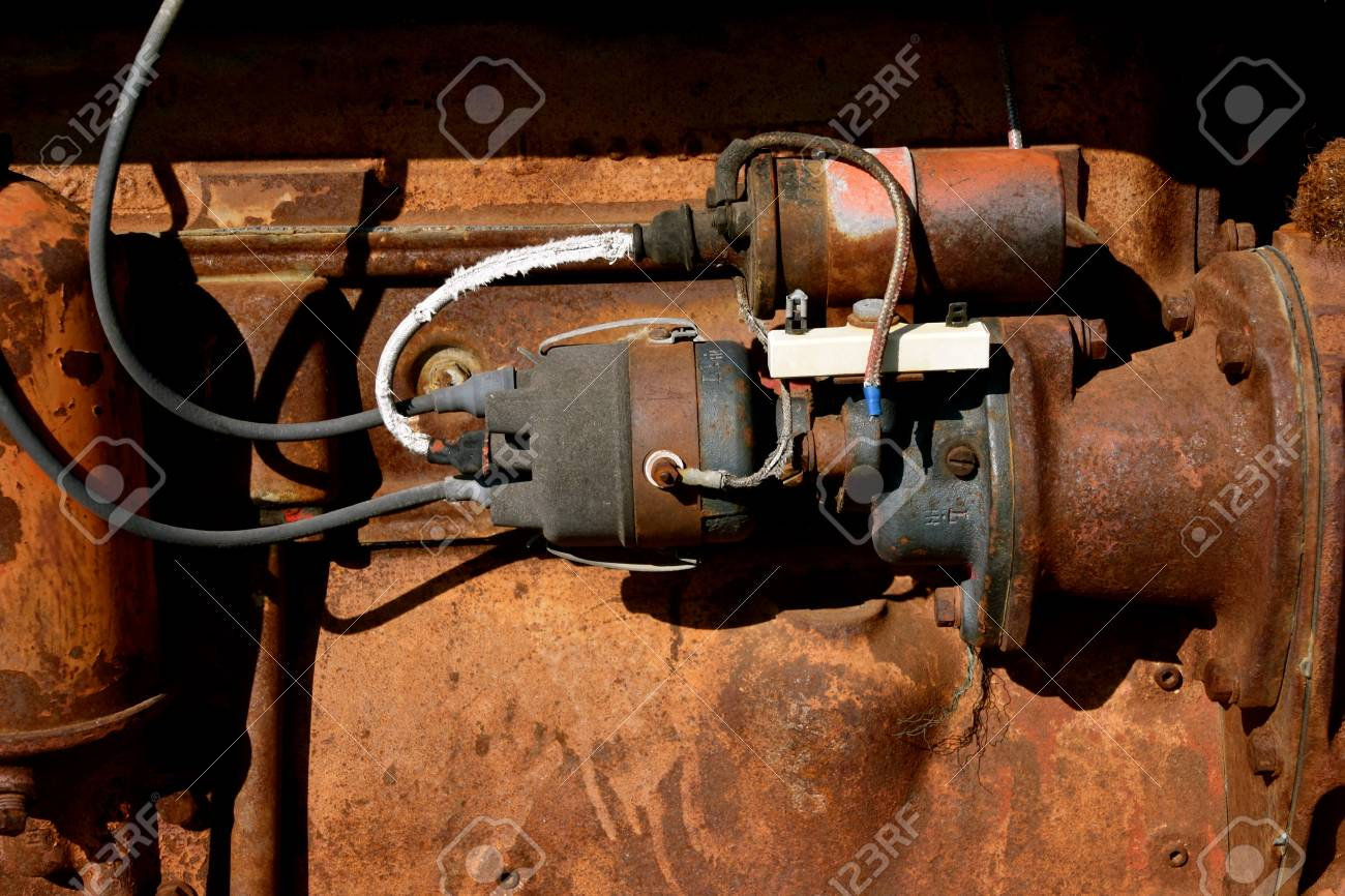 the electrical wiring and headquarters for starting an old rusty Wraped Electrical Wiring