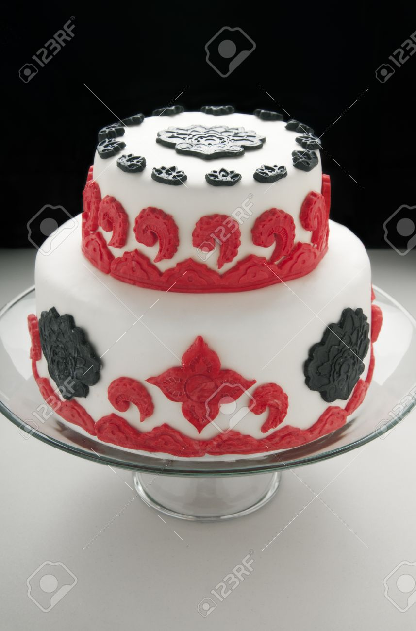 Double Tiered Cake With White Red And Black Fondant Decorations Stock Photo Picture Royalty Free Image 11839296