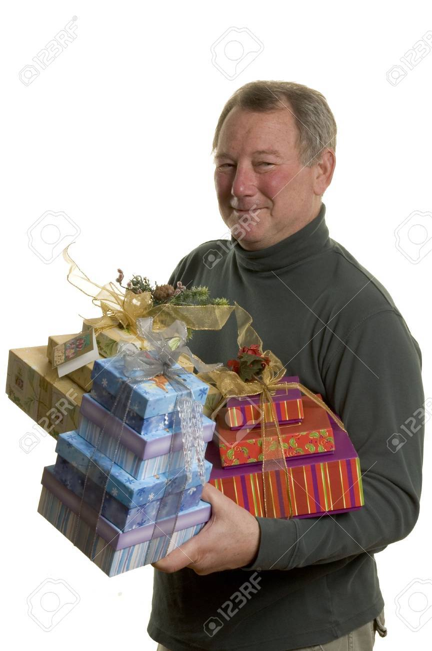 man with gifts excited holiday anniversary birthday middle age handsome Stock Photo - 681691