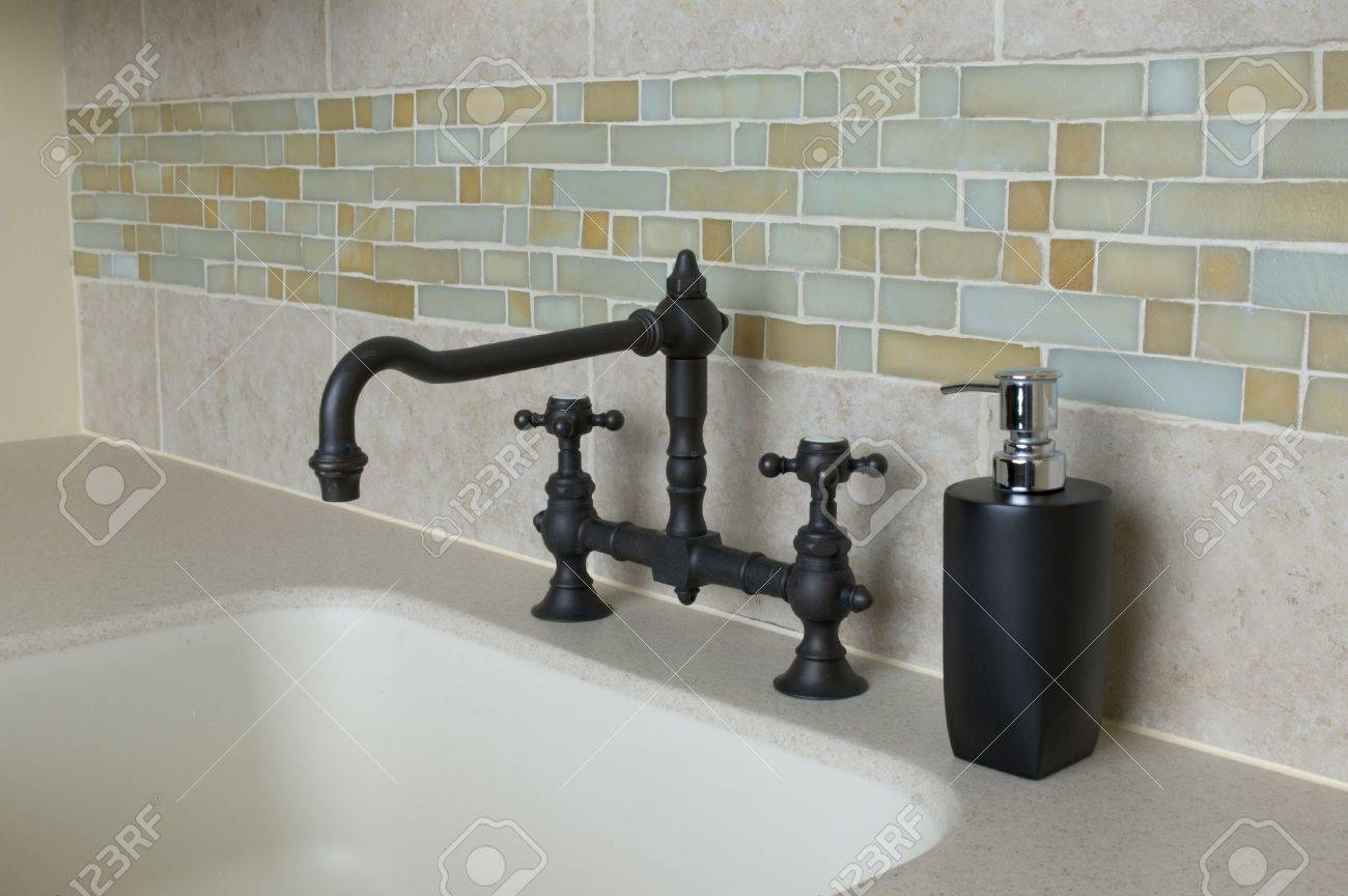 detail custom tile work bathroom faucet wall hot cold control handles shower brass Stock Photo - 682419