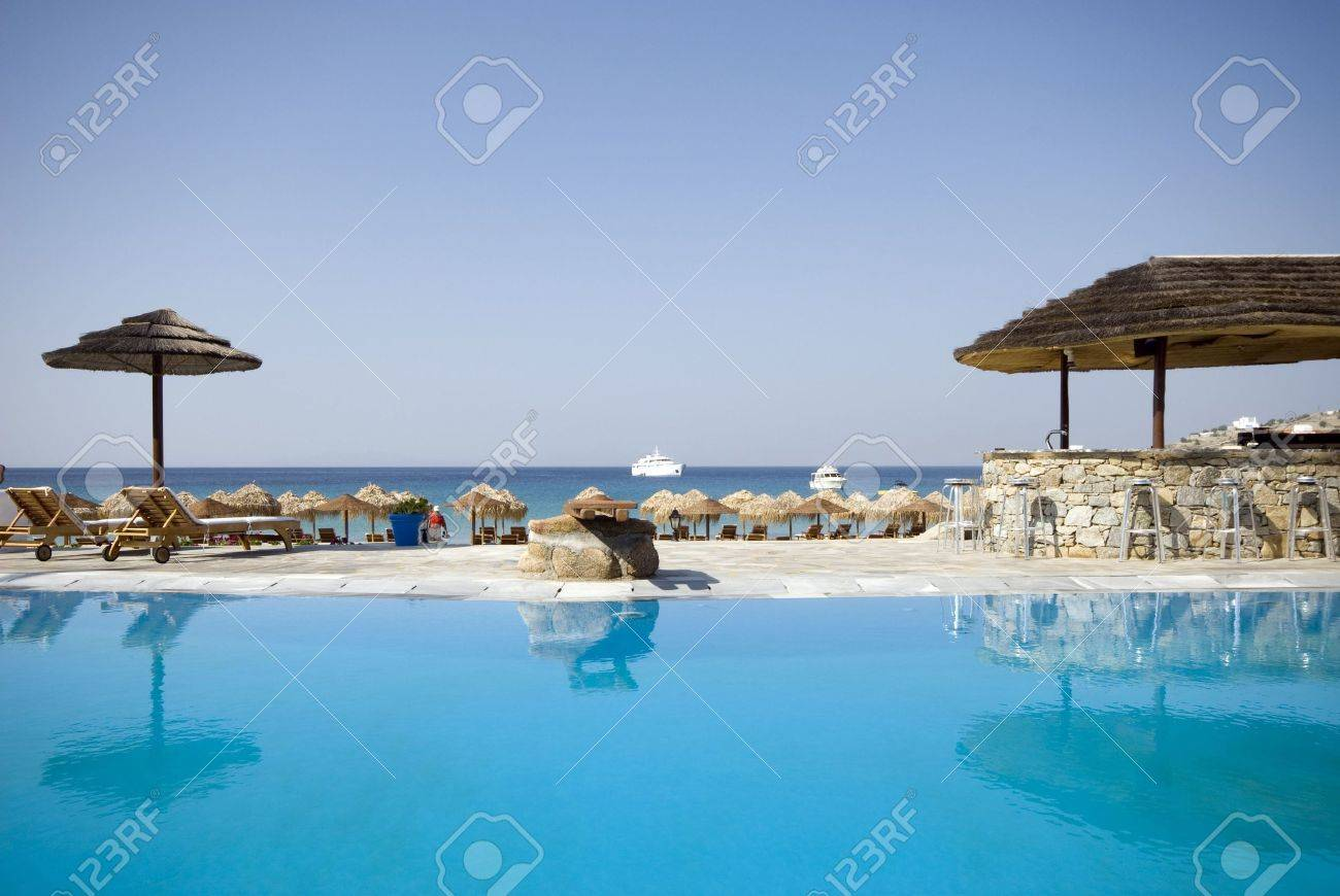 swimming pool by sea at resort hotel luxurious greek island with stone bar Stock Photo - 1358480