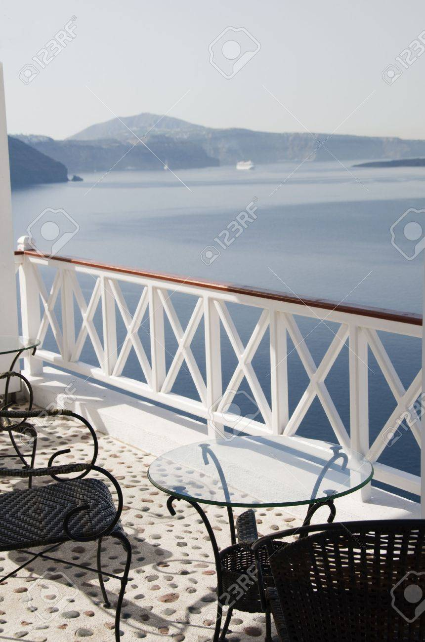 Hotel Patio Table With Chairs Relaxing Scene Over Caldera Volcanic Cliffs  Oia Ia Santorini Cyclades Greek