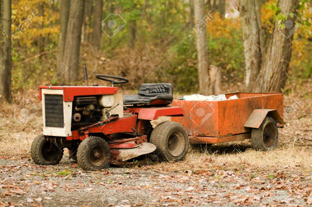 Lawn Tractor Mower Antique Vintage With Hitch And Trailer Stock ...