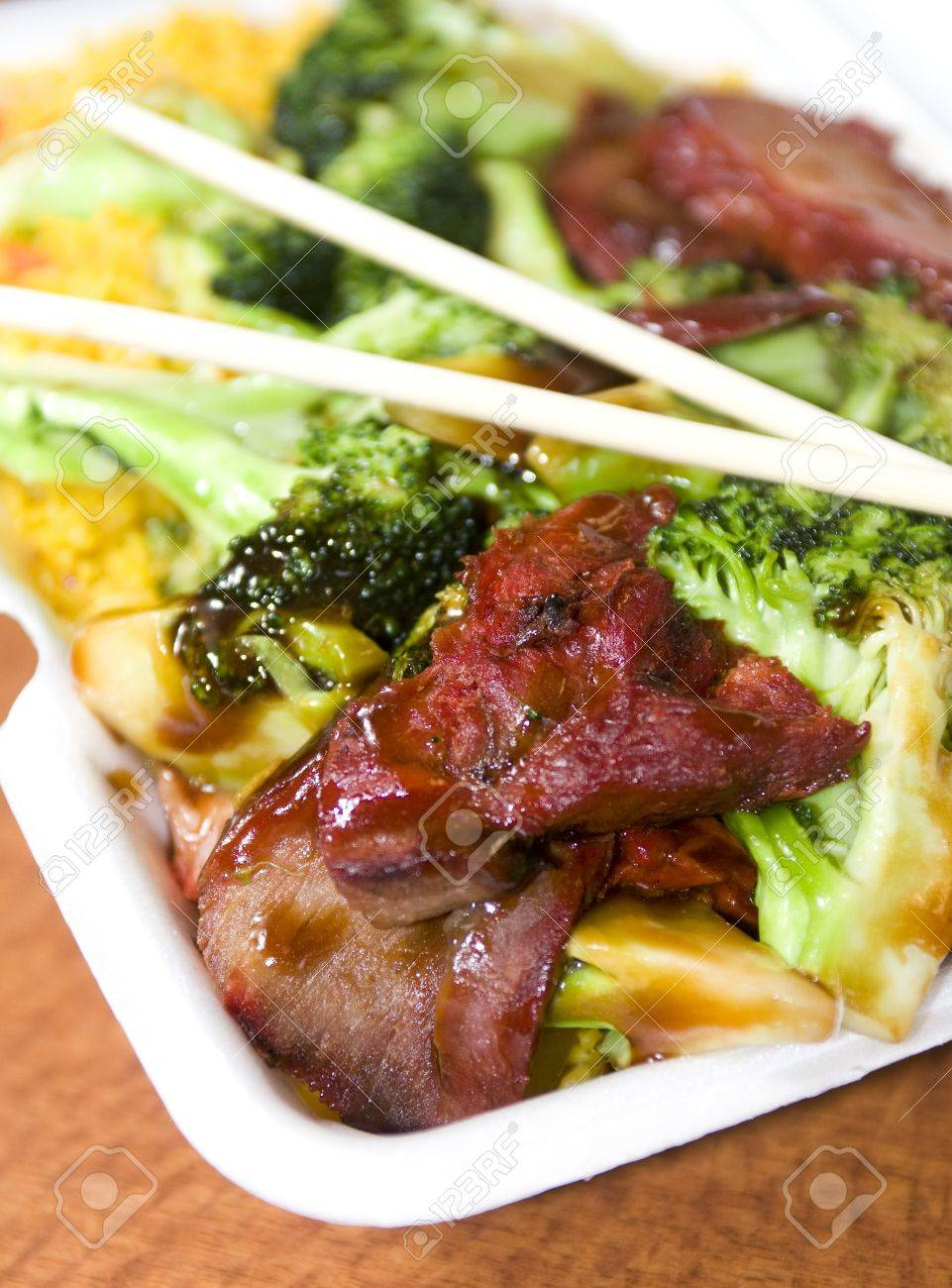 Chinese Food Roast Pork With Broccoli Fried Rice Restaurant Take Out Quick With Chop Sticks Stock