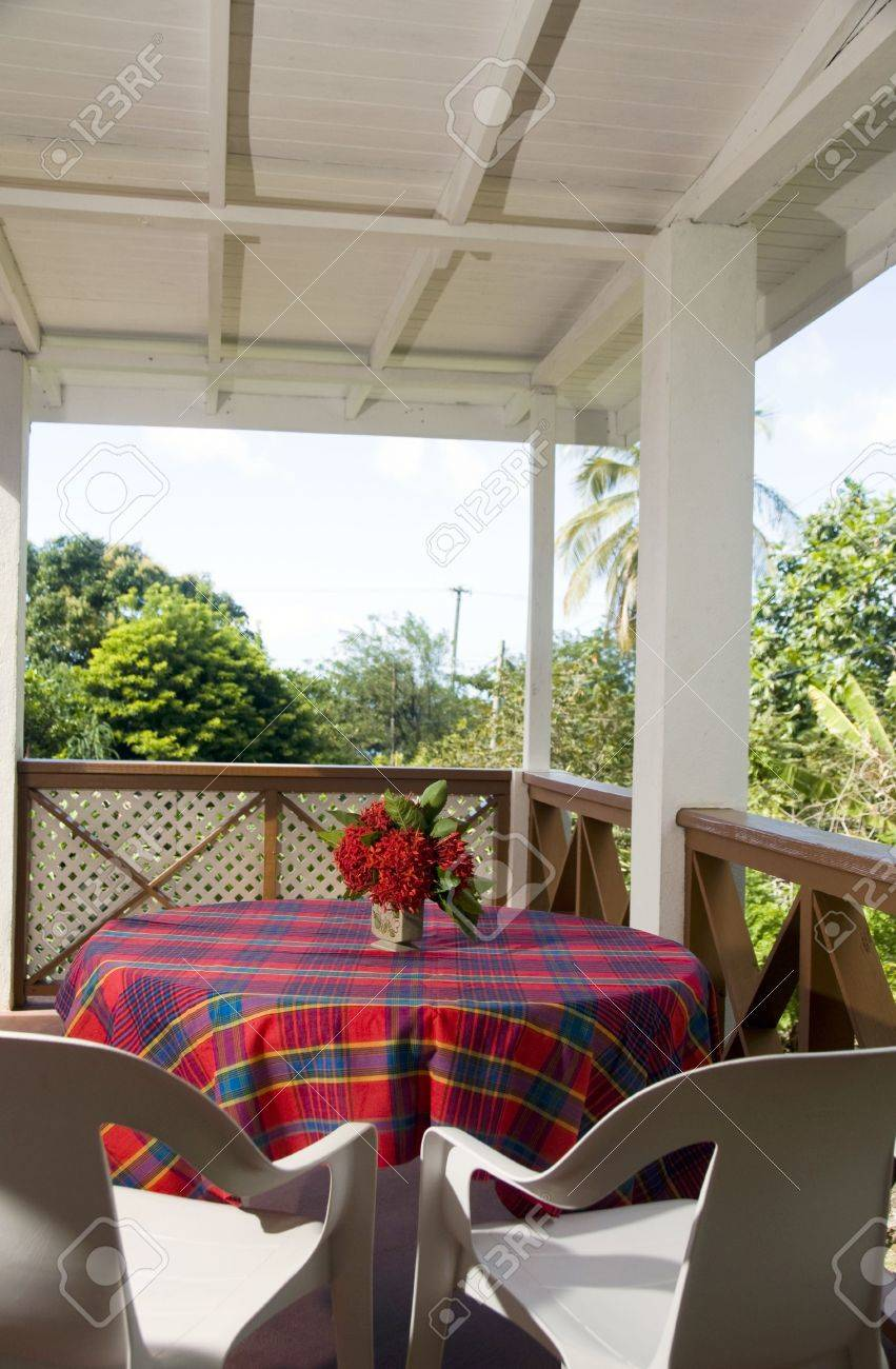 Dining Table On Outdoor Patio Deck With View Of Tropical Jungle And  Caribbean Sea At Budget