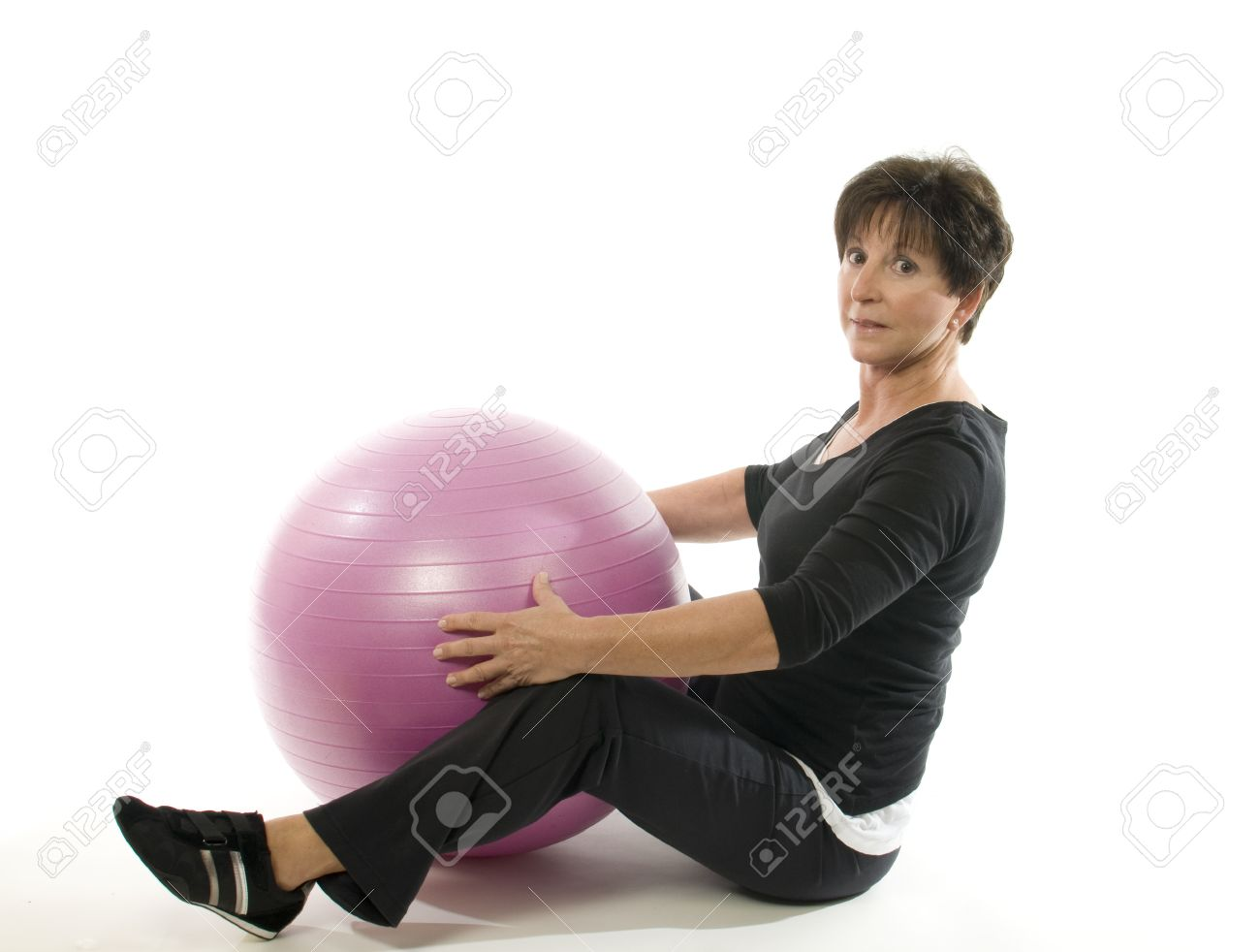 middle age senior woman fitness exercise with core training ball sit ups Stock Photo - 10679210