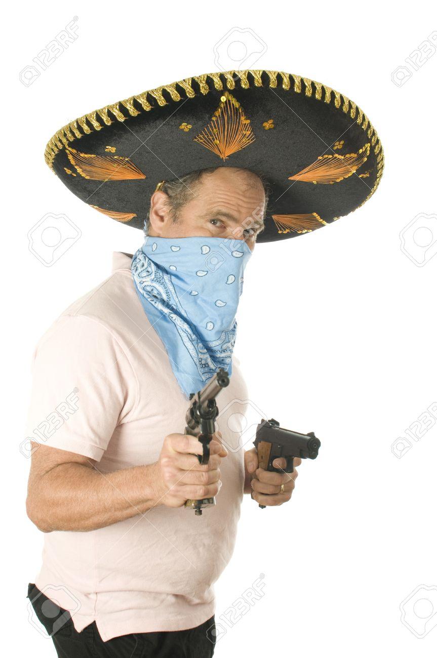 middle age senior tourist male wearing Mexican sombrero Mariachi hat cowboy  bandana handgun pistols Stock Photo aa36ed4628f