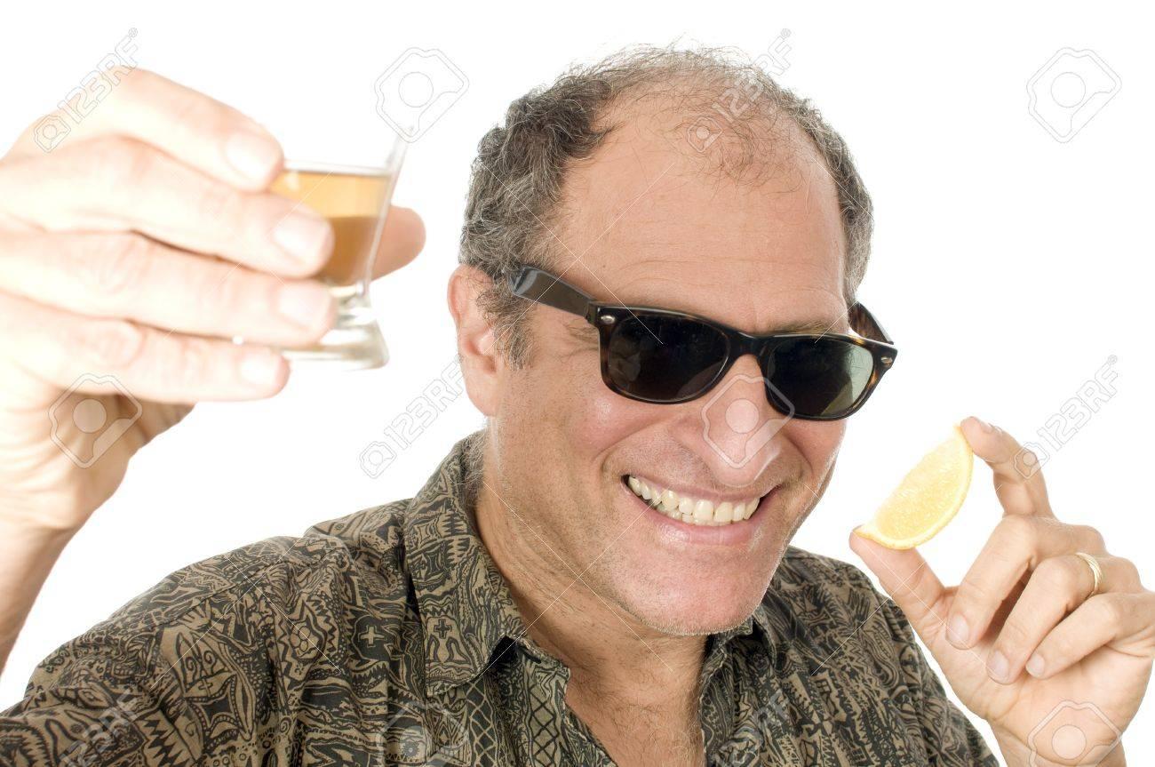 middle age senior tourist male sun glasses drinking tequila shot with slice  of lemon Stock Photo 24b8da818078