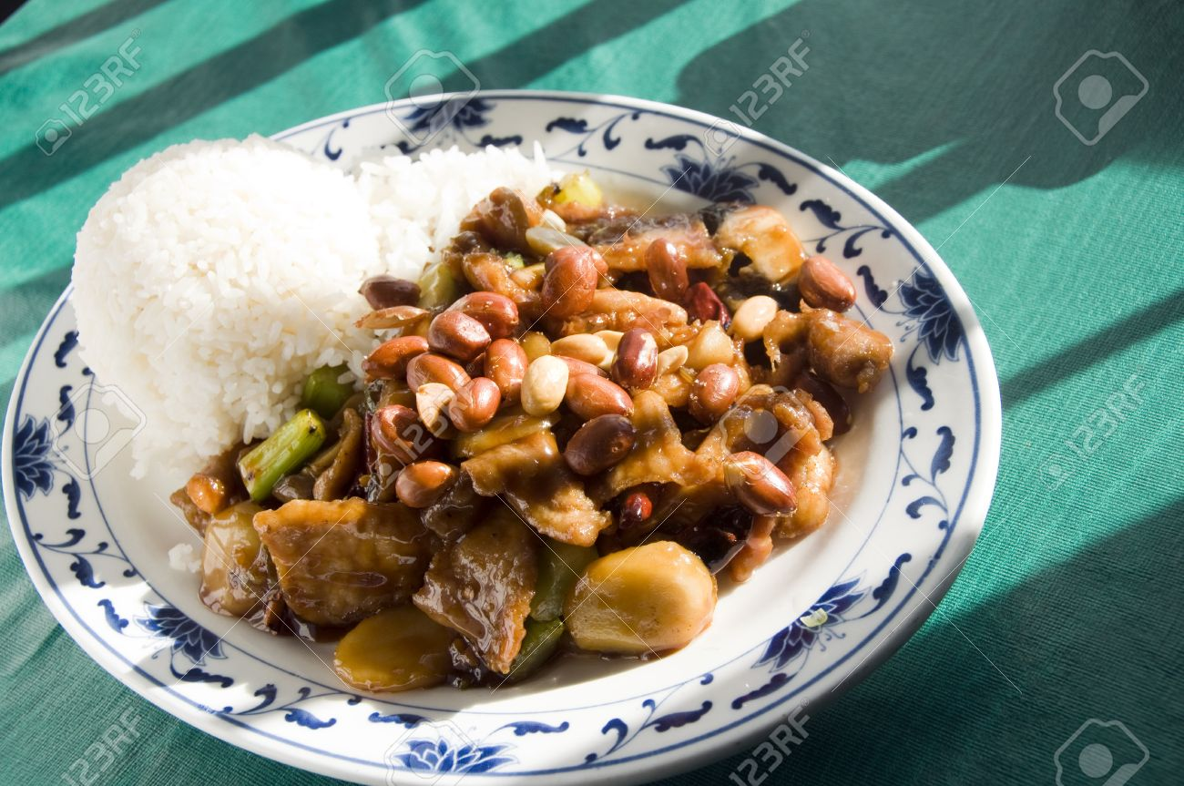 Chinese Food Roast Pork Hot Pepper Sauce Mixed Vegetables And Peanuts Szechuan Style Stock Photo