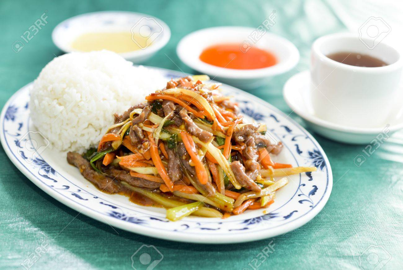 Roast Pork Mixed Vegetables Chinese Food With Tea And Condiments Stock Photo 17576412