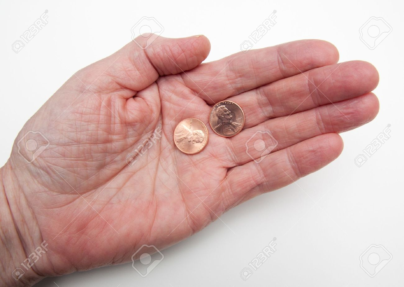 Hand Holding Two Pennies Over White Representing The Concept My Two Cents Worth Add To Likebox