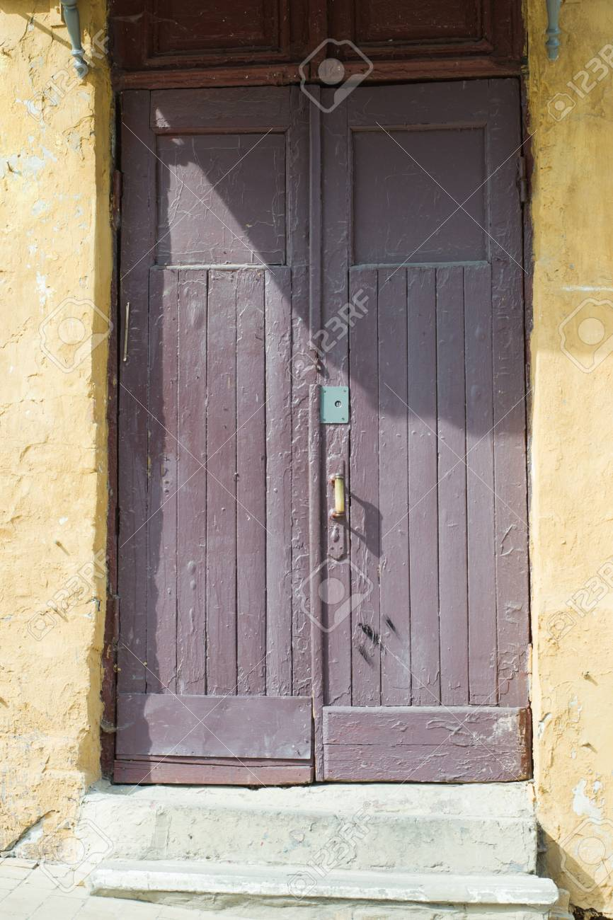 Old Painted Wooden Front Door Of The Building With A Step In Stock