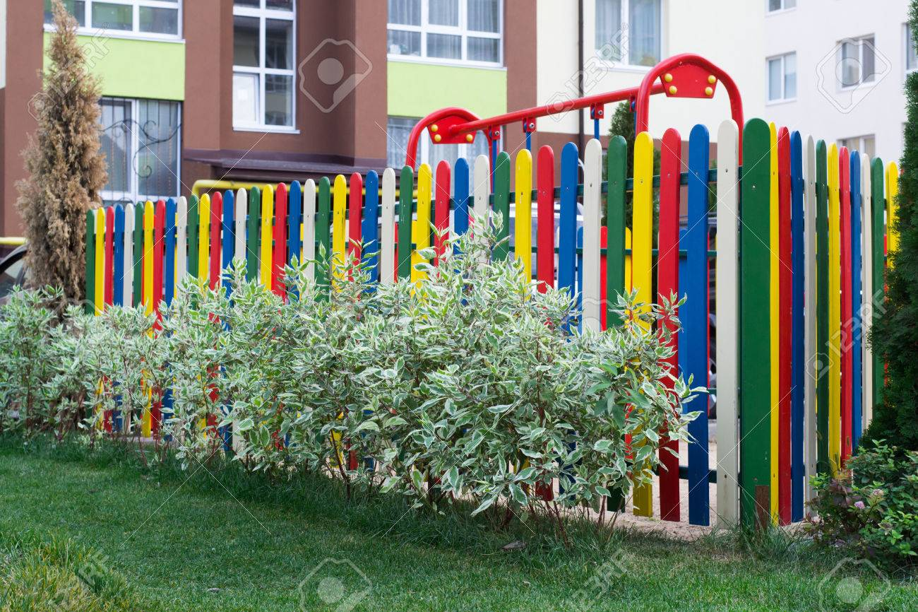 Colorful Playground Is Fenced By A Fence In A Small Green Park ...