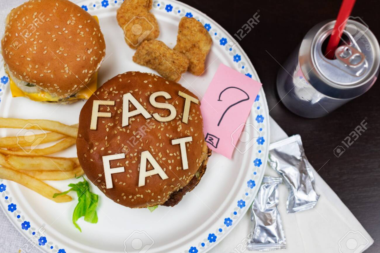 Juicy fast food burgers letters on a juicy burger. Unhealthy eating. Junk food concept. - 138721019