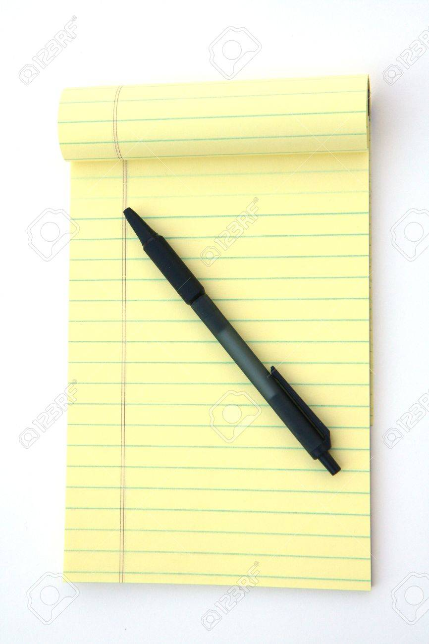 yellow legal pad of paper set against a white background stock photo