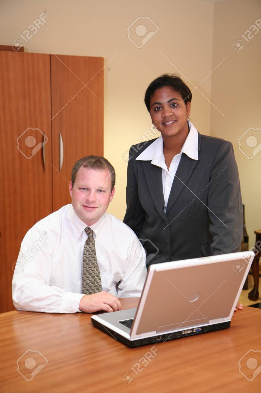 Businesswoman and Businessman looking at a computer Stock Photo - 13301665