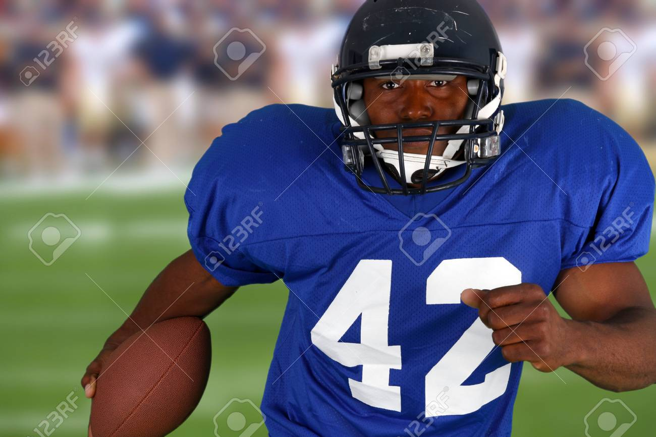 Football player playing in a game on field Stock Photo - 13294172