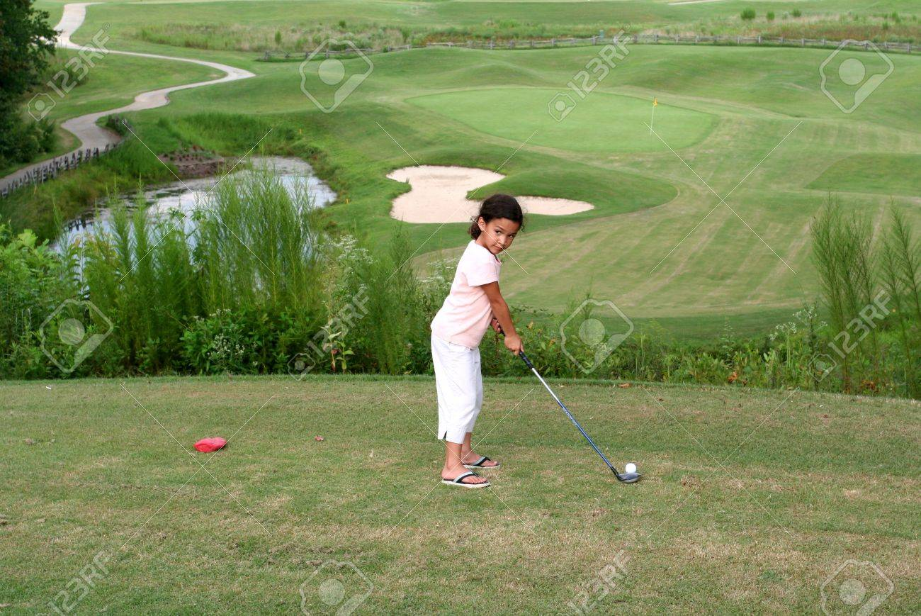 Child Golfing on Course Stock Photo - 13294049