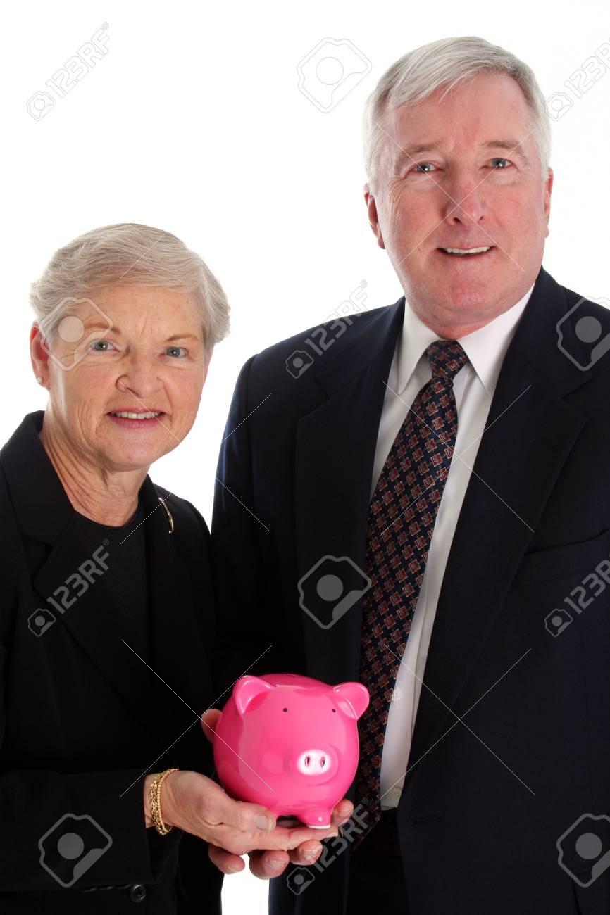 Senior Woman Holding A Pink Piggy Bank Stock Photo - 13298230