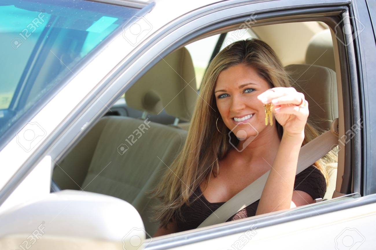 Woman Sitting In Car Holding Set of Keys Stock Photo - 13317889