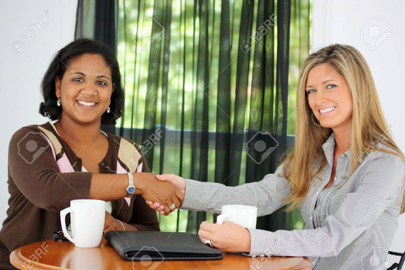 Two Women Shaking Hands In An Office Stock Photo - 13317999