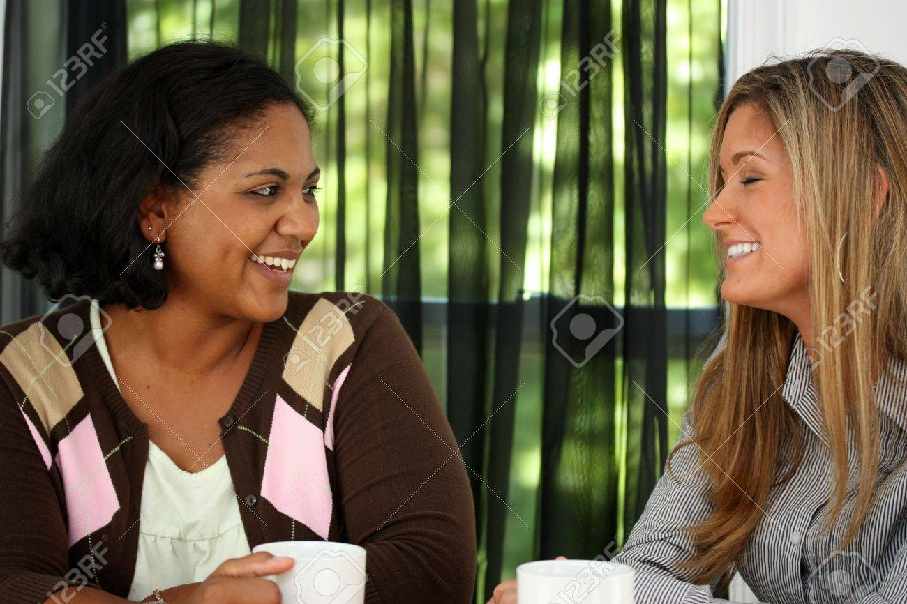 Two Friends Sitting At A Table Together Stock Photo - 13317992
