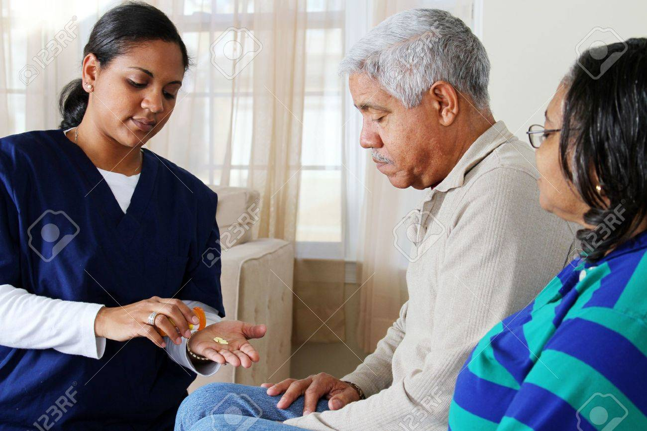 Home health care worker and an elderly couple Stock Photo - 13398886