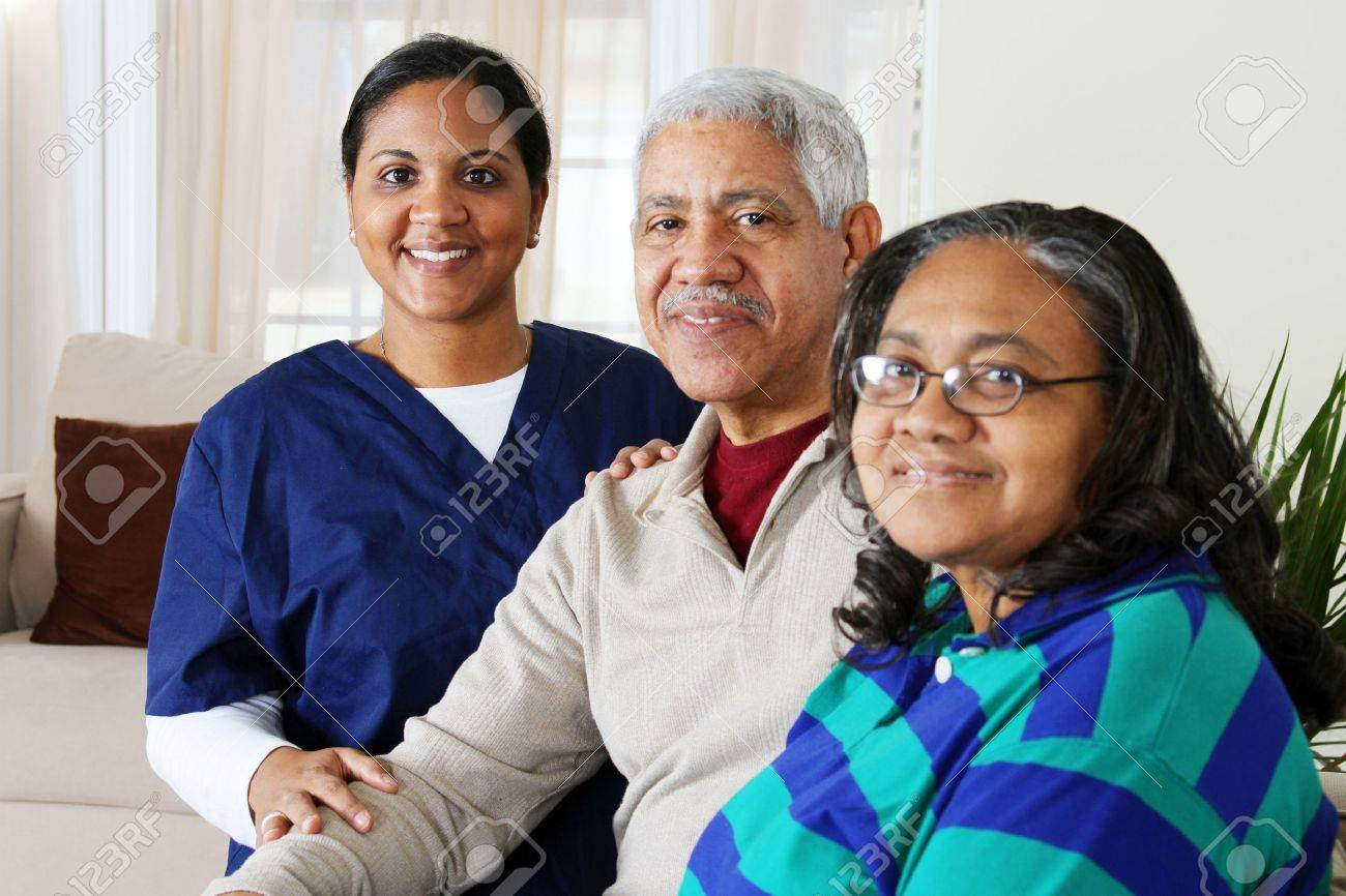 Home health care worker and an elderly couple Stock Photo - 13398928