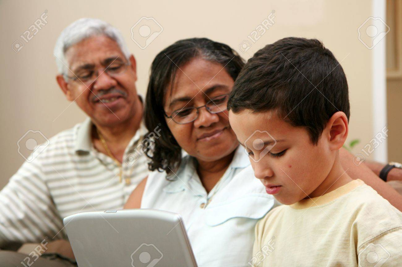 Child on computer with his grandparents Stock Photo - 13410778