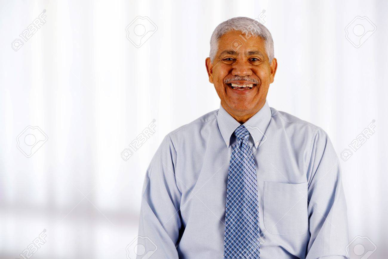 Senior business man working in his office Stock Photo - 13399415
