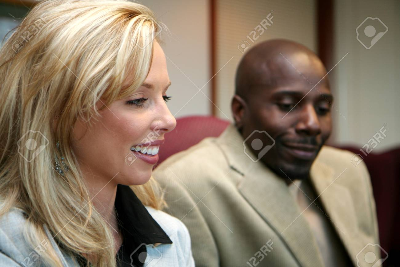 Young caucasian businesswoman with african american man Stock Photo - 13409194