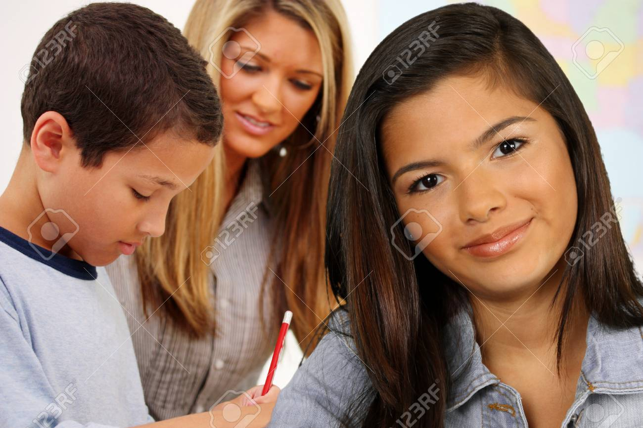 Students And A Teacher At Their School Stock Photo - 13617628