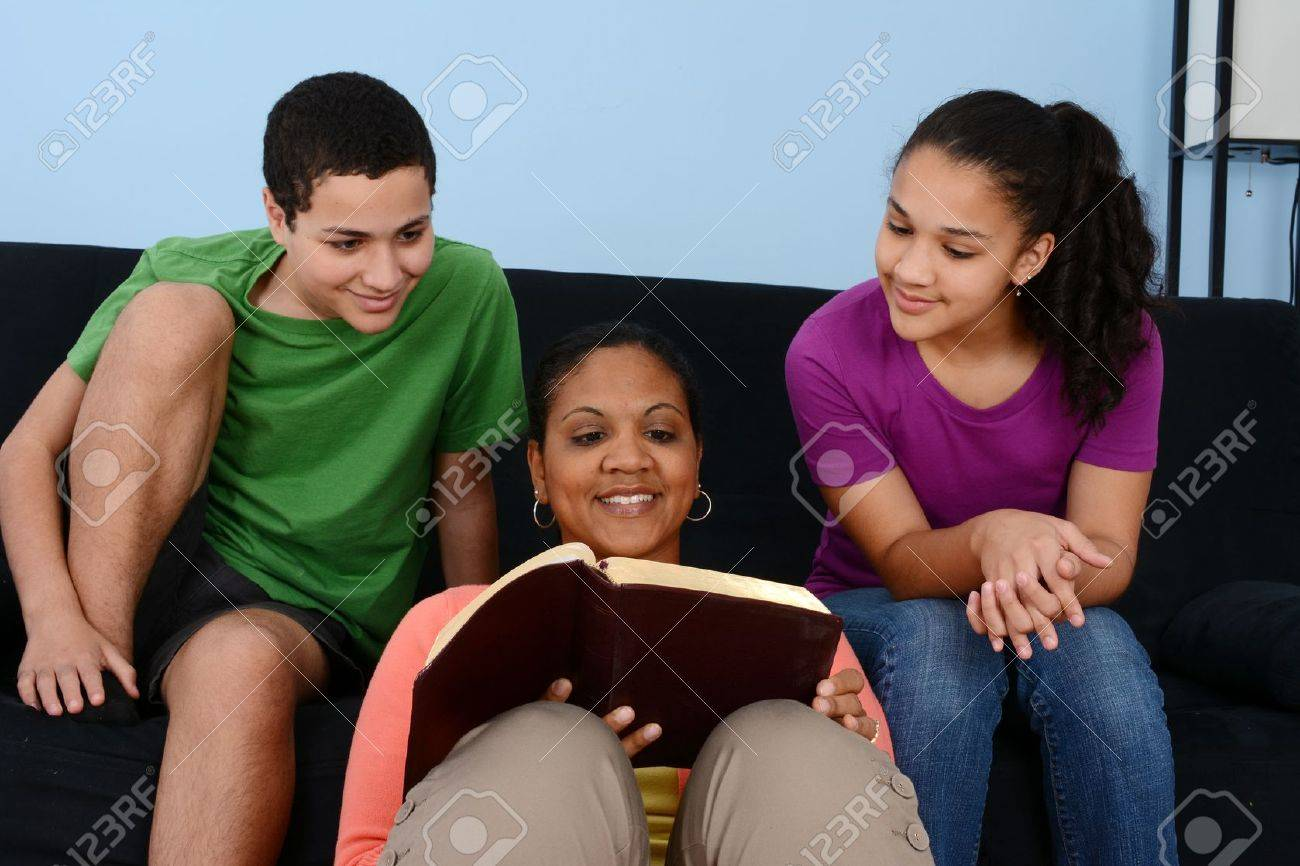 Family studying the bible together in their home Stock Photo - 21976411