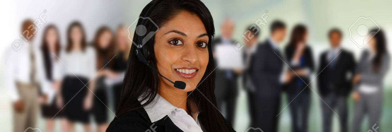 Young woman giving help as a customer service employee Stock Photo - 26979042