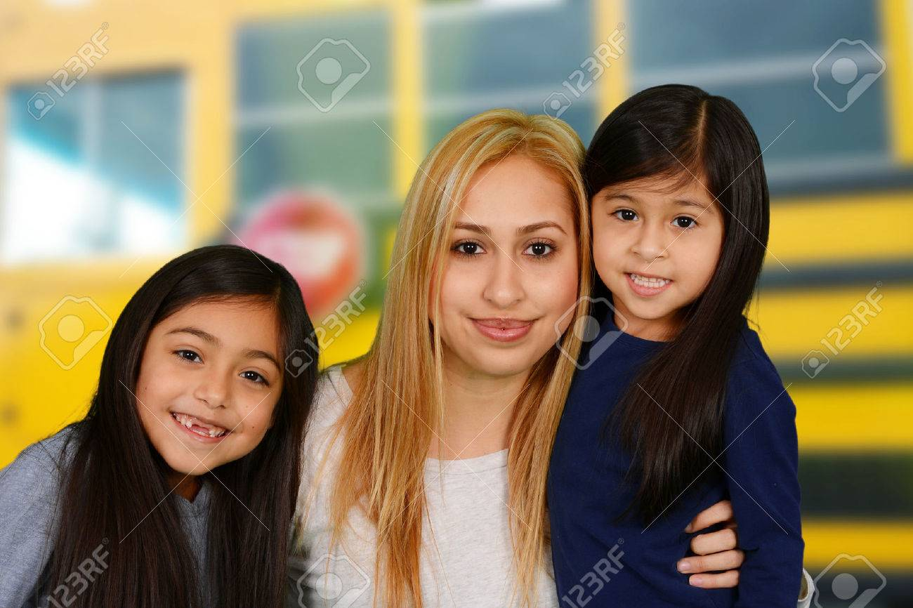 Mother and daughters together by the school bus Stock Photo - 37721606
