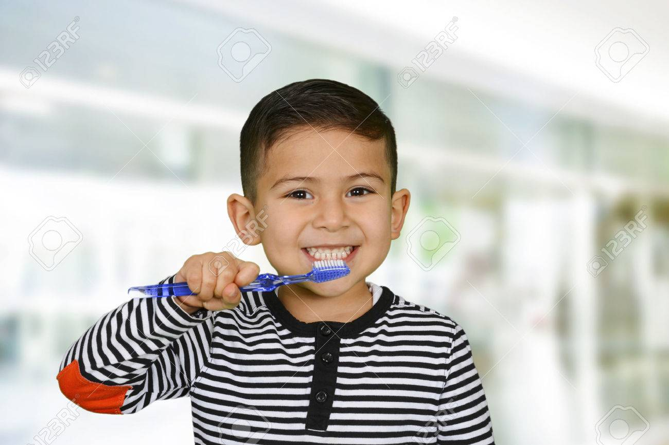 Young child who is brushing their teeth Stock Photo - 37763493