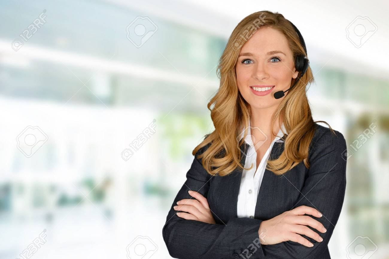 Young woman giving help as a customer service employee Stock Photo - 38730022