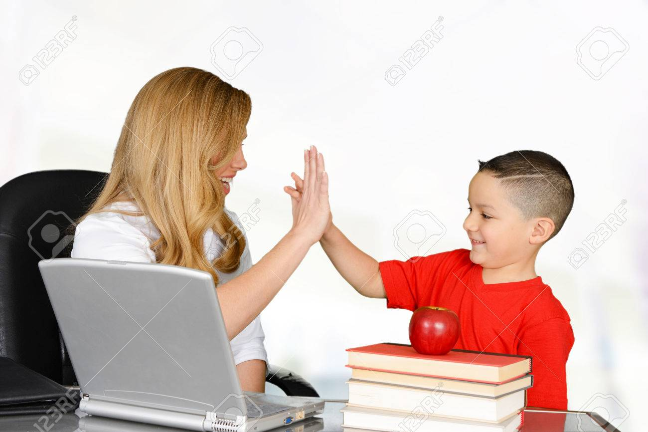 Student and teacher high five in class Stock Photo - 38729589