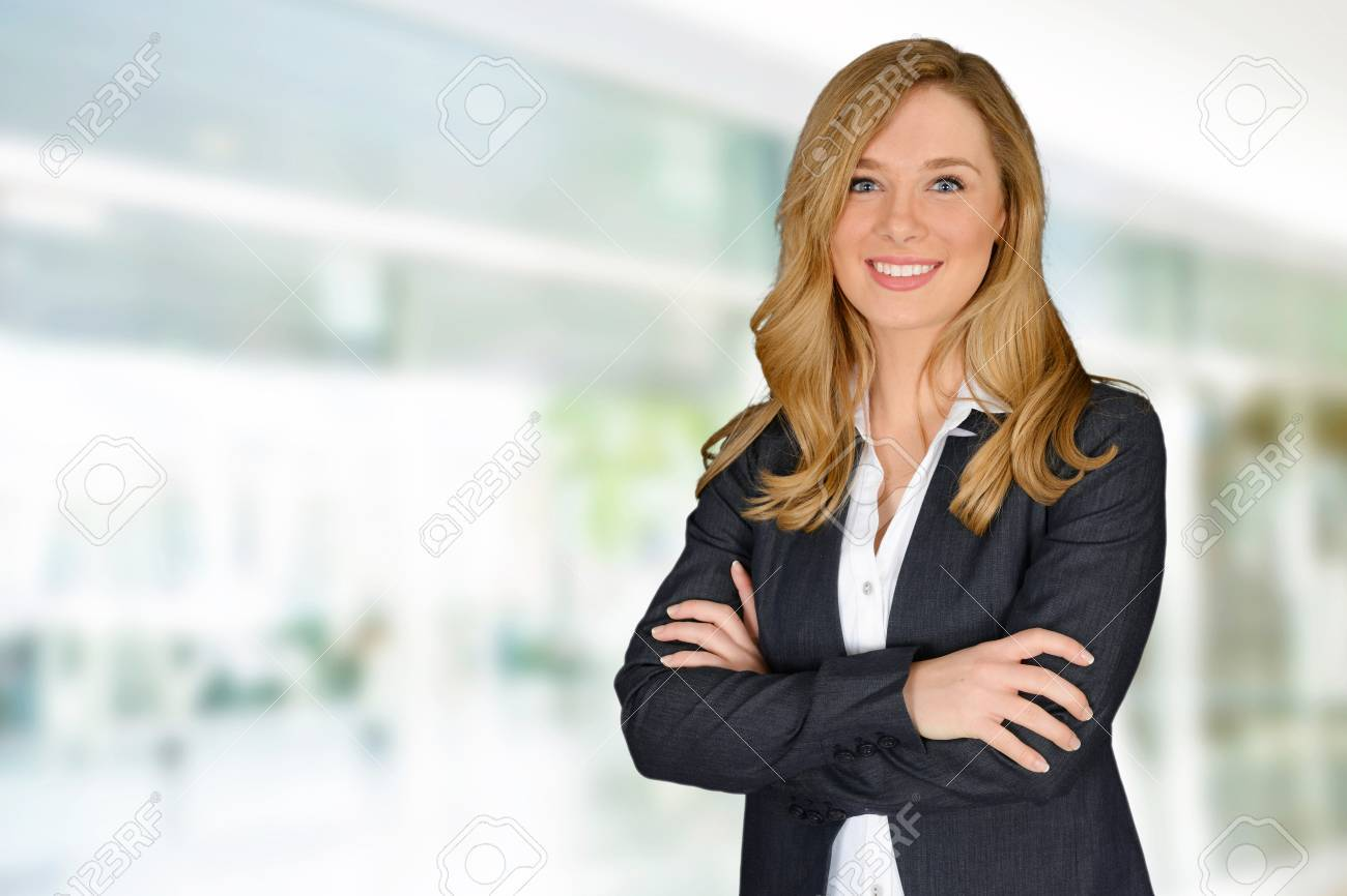 Young successful woman with crossed hands looking at camera Stock Photo - 38730301