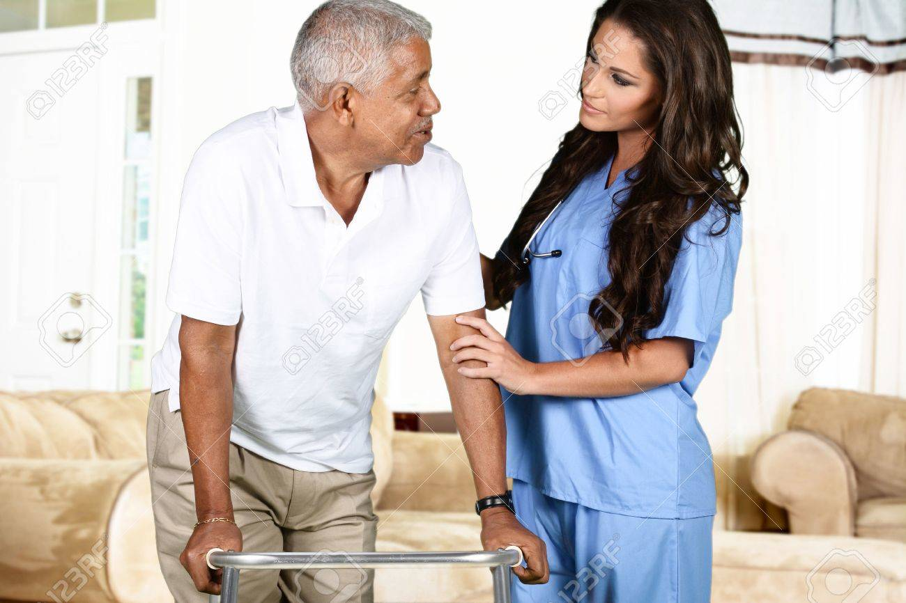 Health care worker helping an elderly man Stock Photo - 43086535