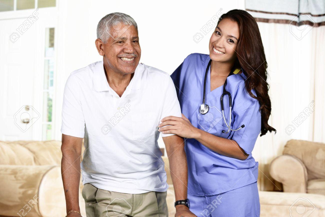 Health care worker helping an elderly man Stock Photo - 43086539
