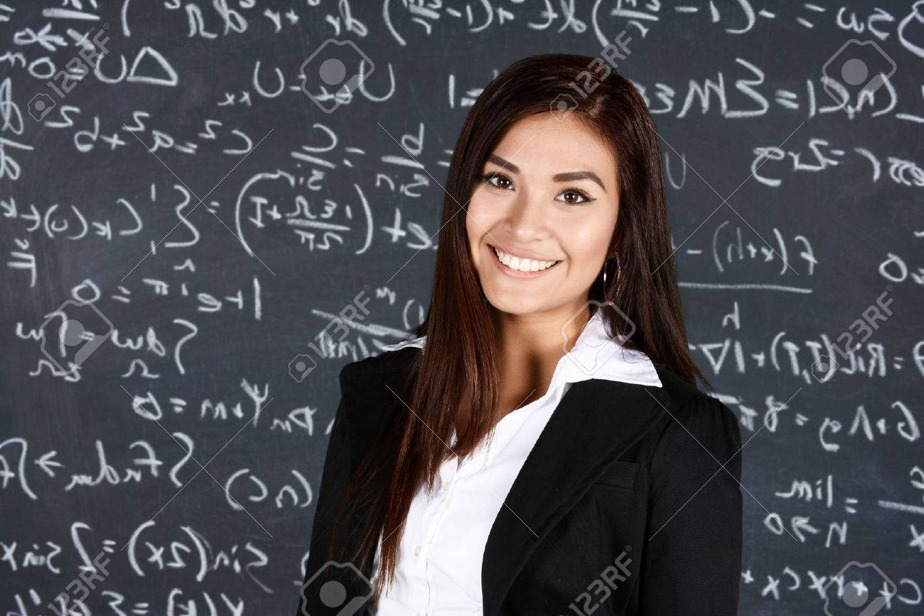 Teacher at school in the classroom ready for work Stock Photo - 43433474