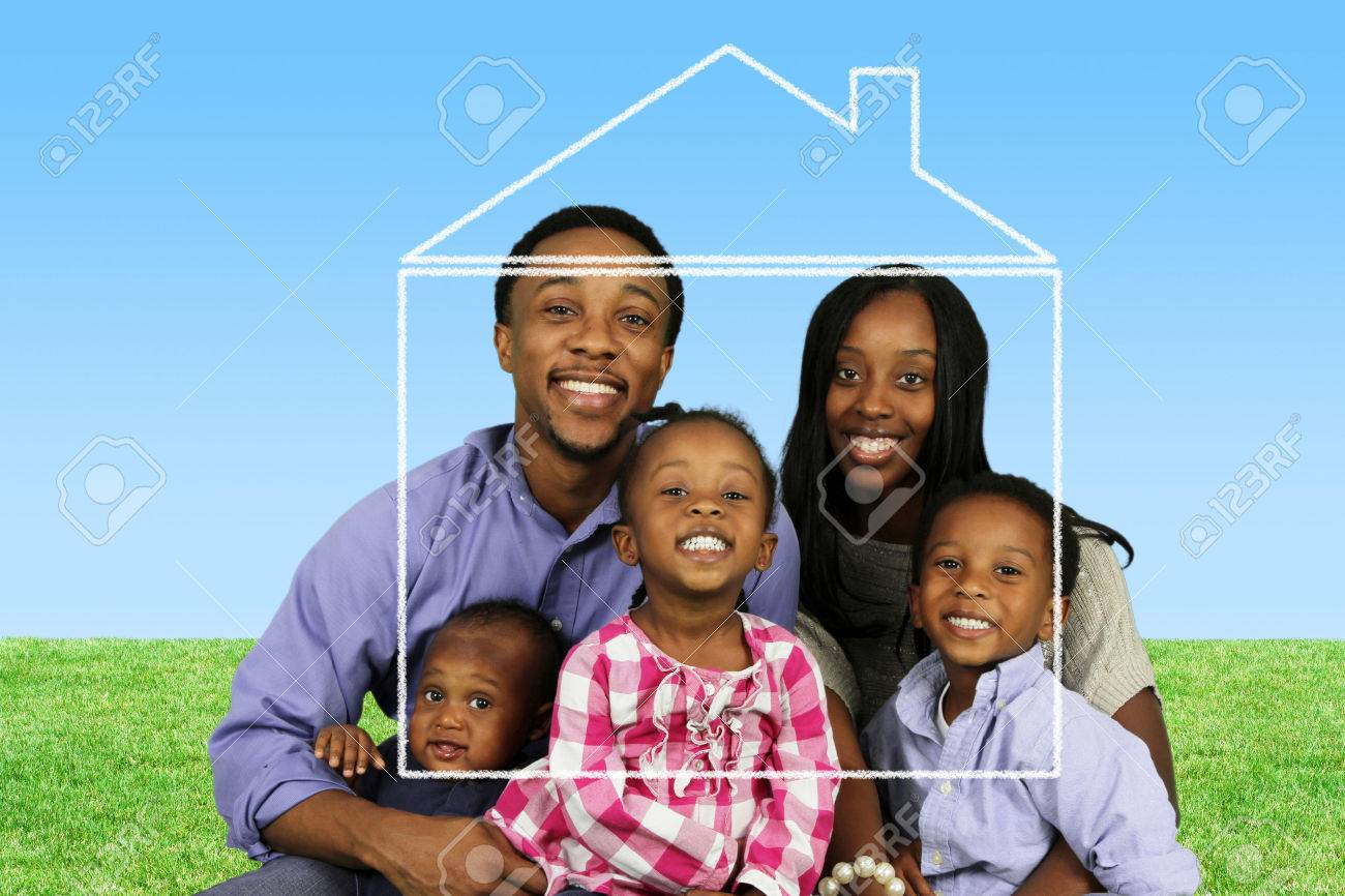 Young family together outside of their home Stock Photo - 43679728