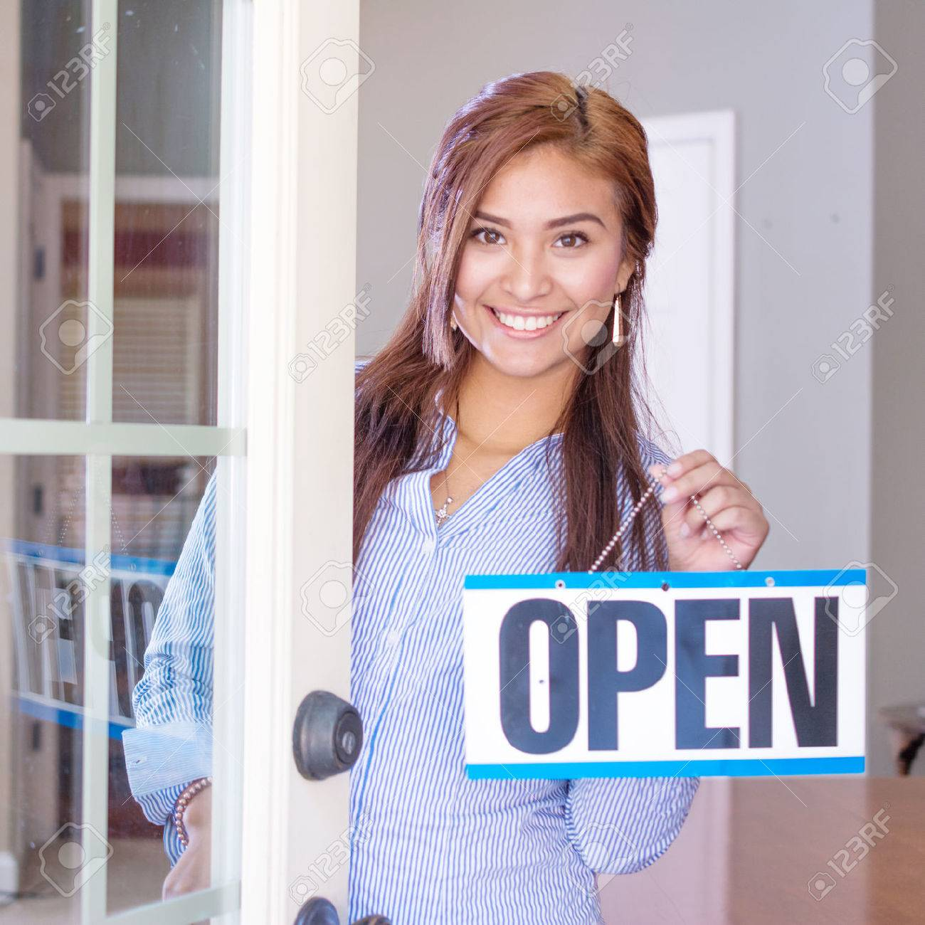 Woman opening her store with an open sign - 45354708